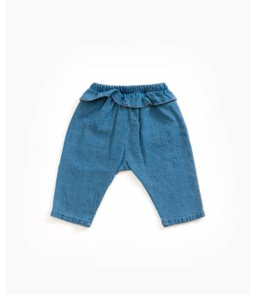 Denim pants with ruffles I...